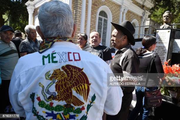 People visit the tomb of Mexican singer and actor Pedro Infante during the 100th anniversary of his birth at the Panteon Jardin in Mexico City on...