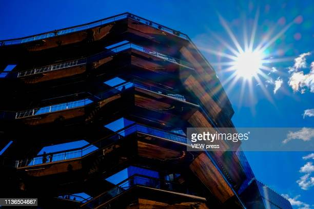 People visit the Vessel at the Hudson Yards real estate development complex on March 17 2019 in New York After more than 6 years of construction and...