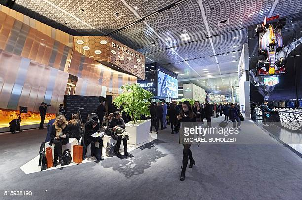 People visit the watch industry's biggest annual trade fair 'BaselWorld' in Basel on March 16 2016 / AFP / MICHAEL BUHOLZER