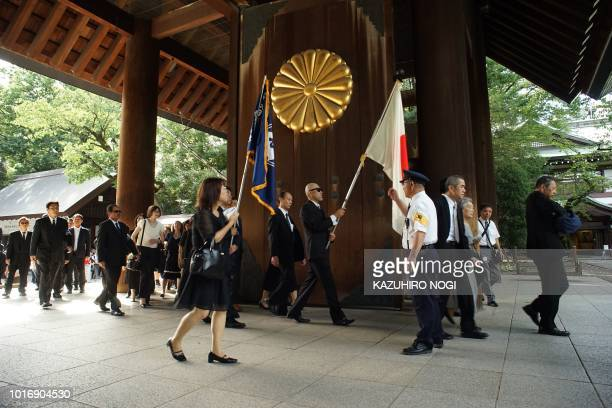 People visit the Yasukuni shrine on the 73rd anniversary of Japan's surrender in World War II in Tokyo on August 15 2018 Japan's Emperor Akihito on...