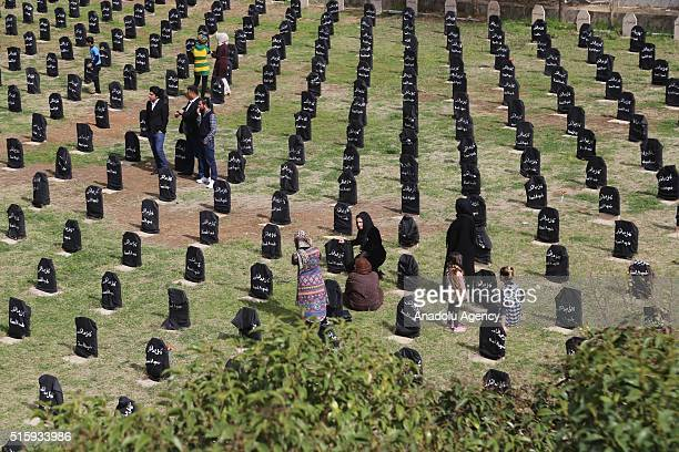 People visit their relatives' Mausoleums during 28th anniversary of the Halabja Massacre in Sulaymaniyah Iraq on March 16 2016 The Halabja Massacre...