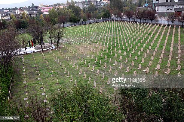 People visit their relatives who died at Halabja chemical attack in Sulaymaniyah Iraq on March 16 2014 Halabja chemical attack lasted only for few...