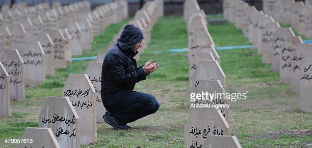 People visit their relatives who died at Halabja chemical attack in Sulaymaniyah, Iraq on March 16, 2014. Halabja chemical attack lasted only for few...