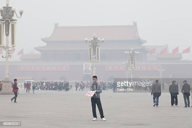 People visit Tiananmen Square blanketed in smog on March 27 2014 in Beijing China An estimated 7 million people die worldwide every year due to air...