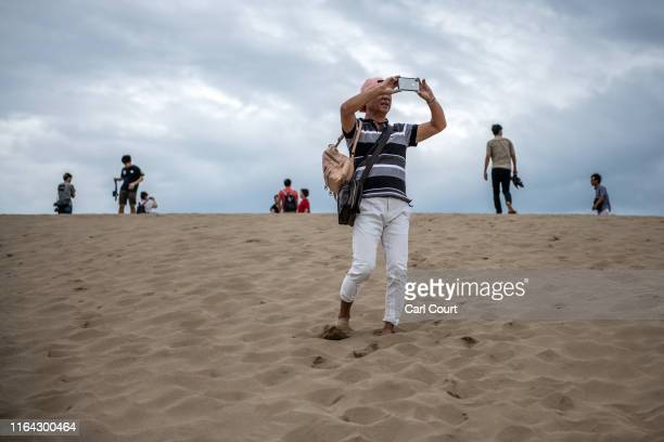 People visit Tottori Sand Dunes on August 27, 2019 in Tottori, Japan. The Tottori Sand Dunes form the only large dune system in Japan and were...