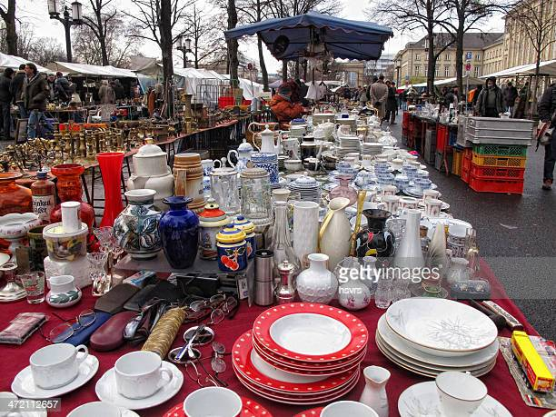 people visiting big flea market in the tiergarten berlin (germany) - garage sale stock pictures, royalty-free photos & images