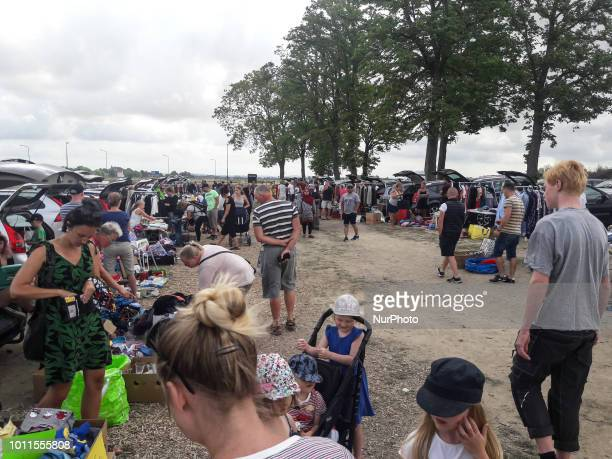 People visiting flea maret are seen in Lund Sweden on 29 July 2018 In Sweden in the summer time the countryside comes alive with flea markets and the...