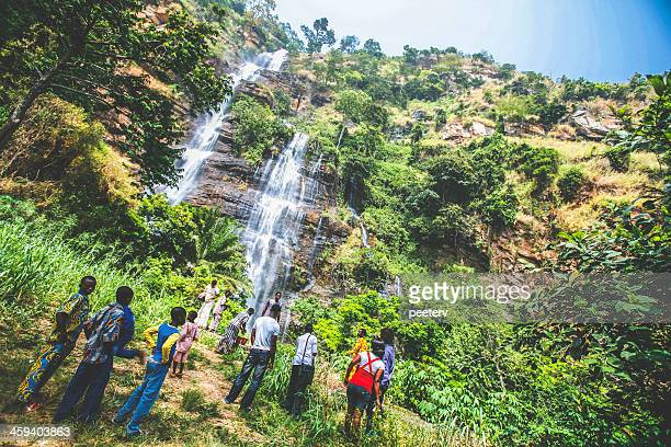 people visiting kpalime waterfalls. - togo stock pictures, royalty-free photos & images