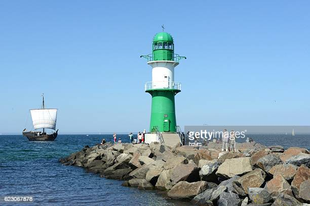 People visiting lighthouse of Warnemuende (Germany)
