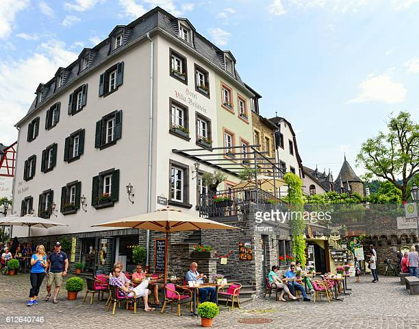 People visiting Moselle river village Beilstein.