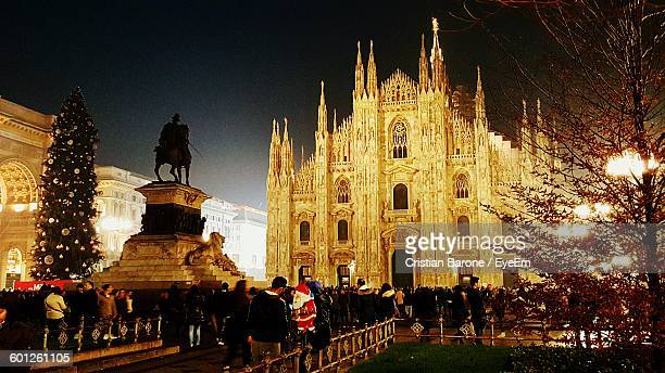 People Visiting Statue Of Vittorio Emanuele And Facade Of Milan Cathedral