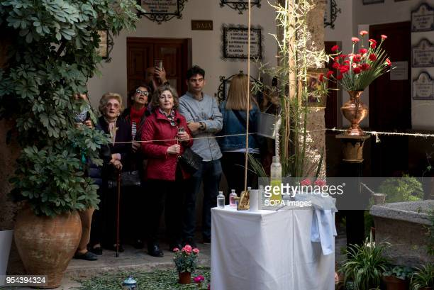 People visiting the cross of the Corrala de Santiago El día de la Cruz or Día de las Cruces is one of the most beautiful festivities in Granada Each...