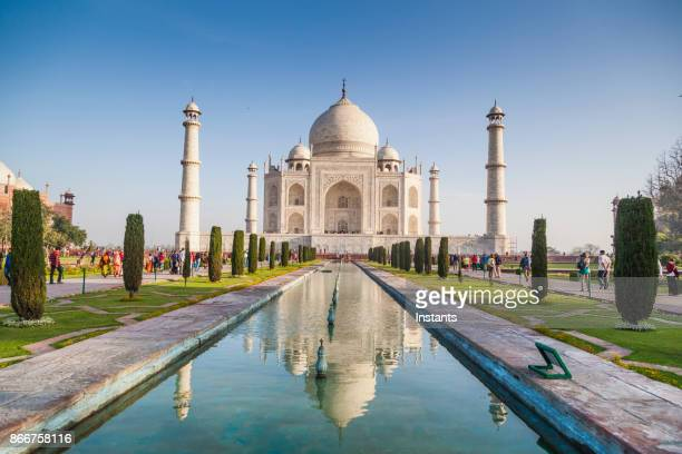 people visiting the magnificent taj mahal in agra. - taj mahal stock photos and pictures