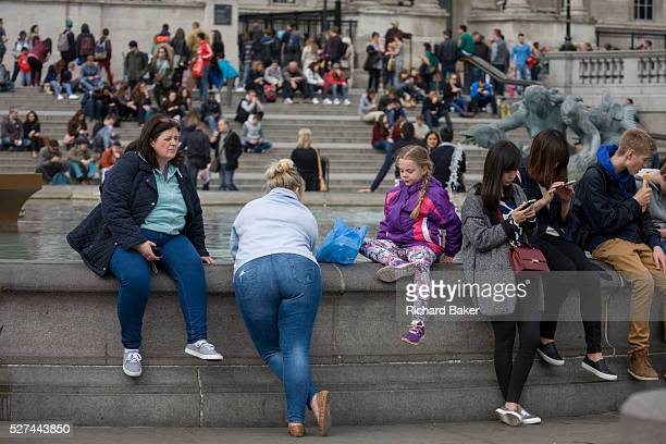 People visiting the sights in the capital gather in Trafalgar Square on 13th April 2015 in London, United Kingdom. This is one of the major tourist...