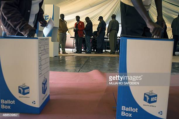People vote as part of the general elections on May 7 2014 in Gugulethu The area has been in the spotlight due to violent protests in the build up to...