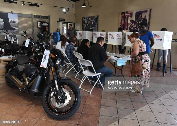 TOPSHOT People vote at a HarleyDavidson showroom and polling station during the midterm elections in Long Beach California on November 6 2018...