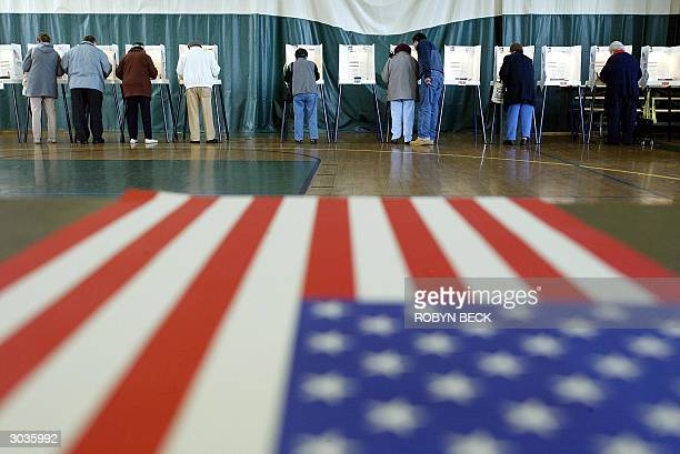 People vote at a polling station 02 March 2004 in Los Angeles California Besides voting in the Super Tuesday primaries for the Democratic...