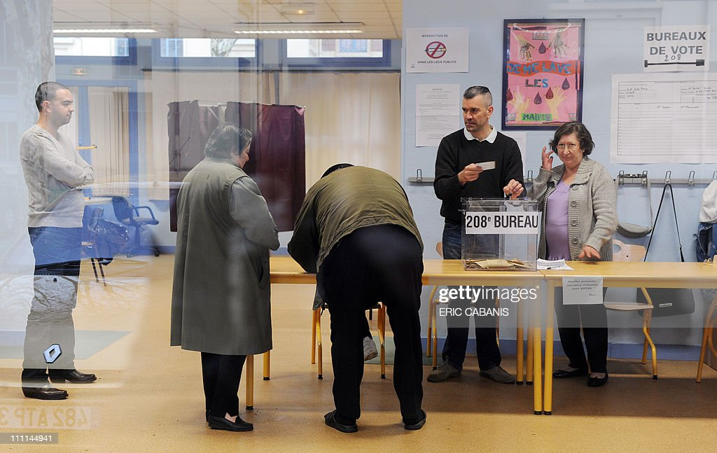 People vote at a polling station in toulouse southwestern france