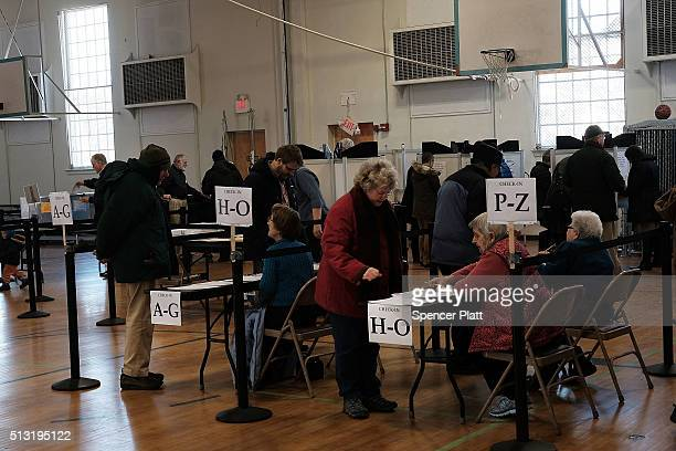 People vote at a polling station on March 1 2016 in Middlebury Vermont Thousands of Americans across the country are participating in Super Tuesday...