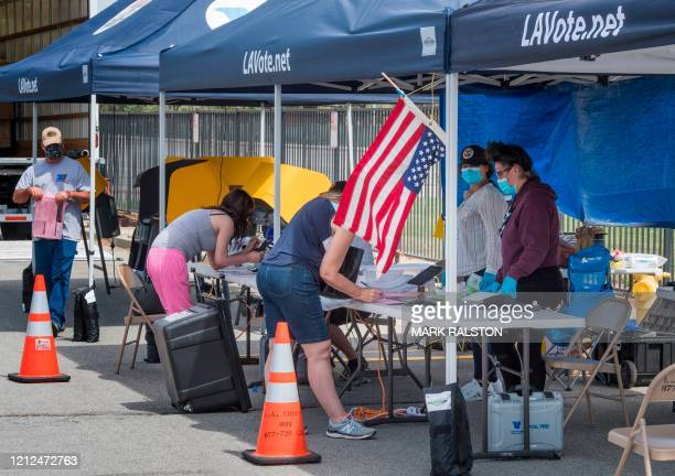 People vote at an early voting station for the special election between Democratic state assemblywoman Christy Smith and Republican businessman and...