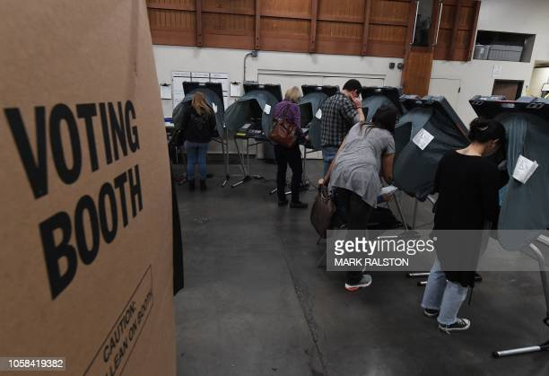 People vote at an Orange County polling station inside a fire station during the midterm elections in Huntington Beach, California, on November 6,...