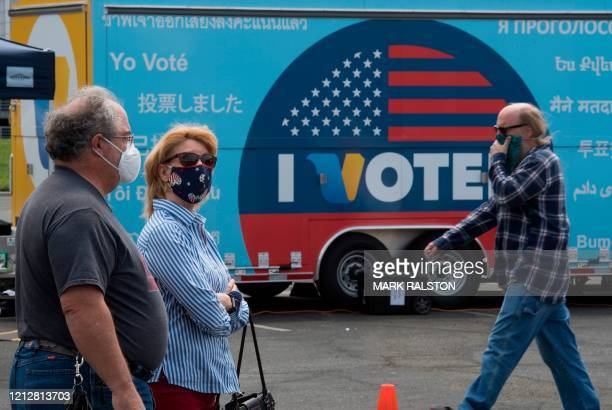 People vote at an voting station for the special election between Democratic state assemblywoman Christy Smith and Republican businessman and exNavy...