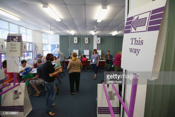 People vote at Palm Beach Currumbin State High in the electorate of McPherson on election day on September 7 2013 in Gold Coast Australia Voters head...