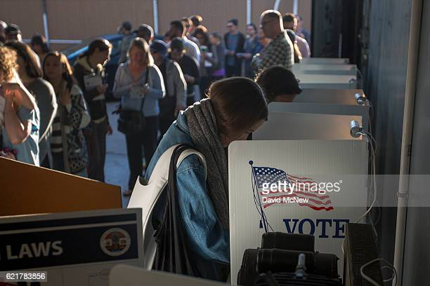 People vote at the Los Angeles Lifeguard station at Venice Beach on November 8 2016 in Los Angeles United States In addition to choosing between...