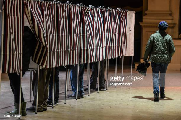 People vote at the Montpelier Town Hall on November 6, 2018 in Montpelier, Vermont. Turnout is expected to be high nationwide as Democrats hope to...