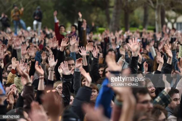 People vote during a general assembly of students and staff from Paul Valery University in Montpellier on March 27 2018 Students have been blocking...