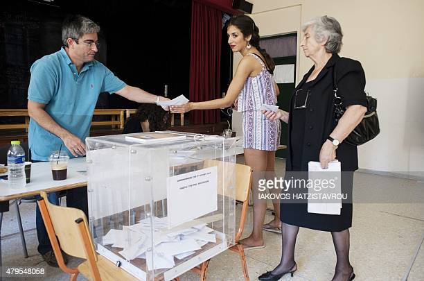 People vote during the Greek referendum on July 5 2015 in Aegina Greek voters headed to the polls today to vote in a historic tightly fought...