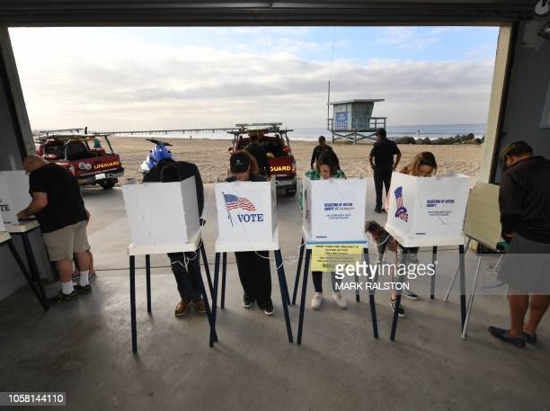 TOPSHOT People vote during the midterm elections beside the beach at the Venice Beach Lifeguard station in California on November 6 2018 Americans...