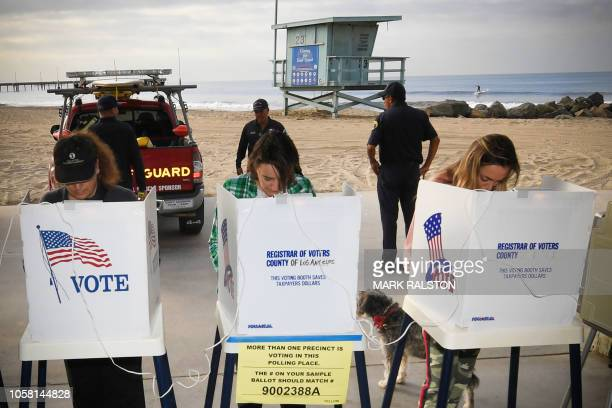People vote during the midterm elections beside the beach at the Venice Beach Lifeguard station in Los Angeles on November 6 2018 Americans started...