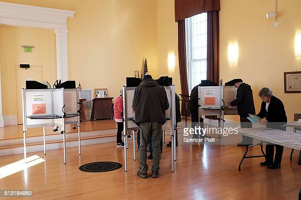 People vote in a church being used as a polling station on March 1 2016 in FerrisburghVermont Thousands of Americans across the country are...