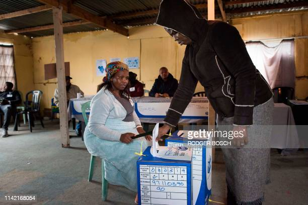 People vote in a large shack being used as a voting station in an impoverished area in Khayelitsha on May 8 2019 in Cape Town during South Africa's...