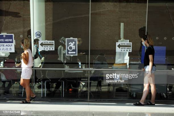 People vote in a primary election for city state and federal offices at the Brooklyn Museum on June 23 2020 in New York City The most watched race of...