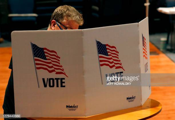 People vote in the 2020 general election at Life Stream Church on November 3, 2020 in Allendale, Michigan. - Americans were voting on Tuesday under...