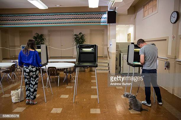People vote in the California primary at St Teresa of Avila Catholic Church on June 7 2016 in San Francisco California Six states including...
