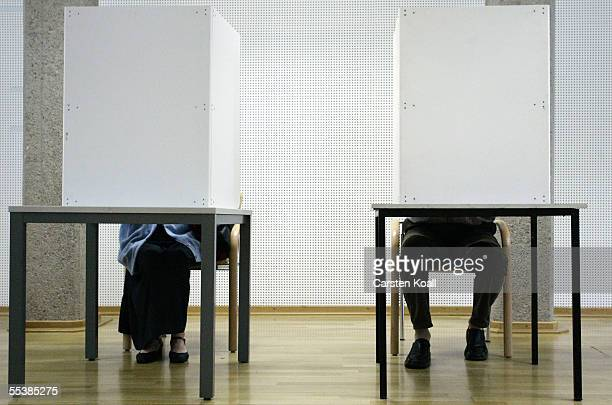 People vote in the central polling station September 12 2005 in Dresden Germany The upcoming election has been postponed until October 2 for the...
