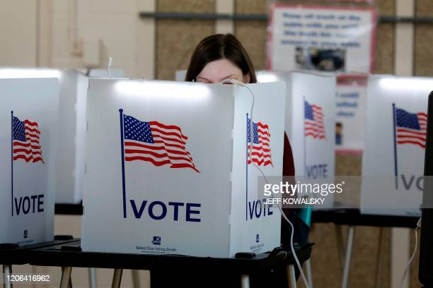 People vote in the Michigan primary election at Chrysler Elementary School in Detroit Michigan on March 10 2020 Voters in Michigan and five other...