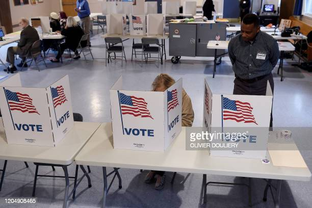People vote in the Super Tuesday primary at Belvedere Elementary School March 3 2020 in Falls Church Virginia Fourteen states and American Samoa are...