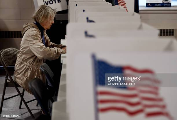 People vote in the Super Tuesday primary at Frizzell Parrish Hall on March 3 2020 in Annandale Virginia Fourteen states and American Samoa are...