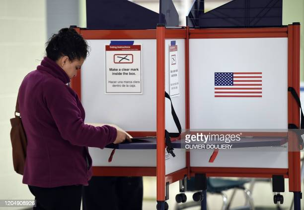 People vote in the Super Tuesday primary at Wakefield High School on March 3 2020 in Arlington Virginia Fourteen states and American Samoa are...