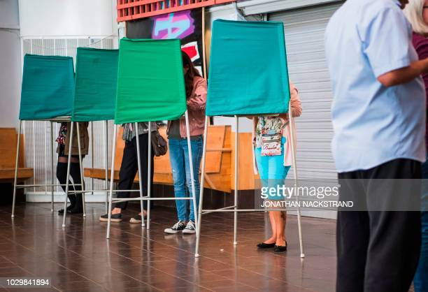 People vote in the Swedish general elections at a polling station in the suburb of Rinkeby north of Stockholm on September 9 2018