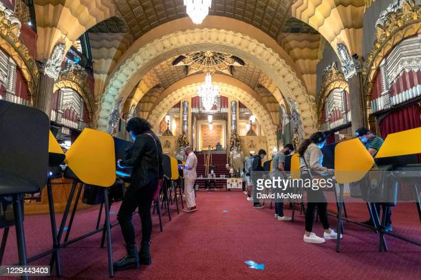 People vote inside the historic Hollywood Pantages Theatre on November 3, 2020 in Los Angeles, California. After a record-breaking early voting...