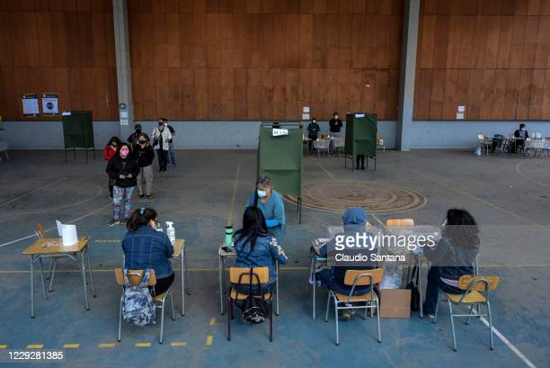 People vote on a referendum on whether to draft a new constitution on October 25, 2020 in Santiago, Chile. After months of protests Chileans started...