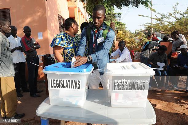 People vote on April 13 2014 at a polling station on a street corner in Bissau GuineaBissau held watershed elections on Sunday for a president and...