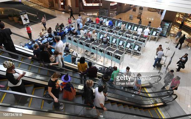 People vote on the first day of early voting at the Meadows Mall on October 20 2018 in Las Vegas Nevada Early voting for the midterm elections in...