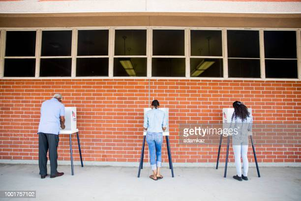 people voting in a government election - polling place stock pictures, royalty-free photos & images