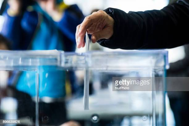 People voting with his ballot during the 21D Catalan election of 2017 on December 21 2017 in Barcelona Sant Cugat Spain